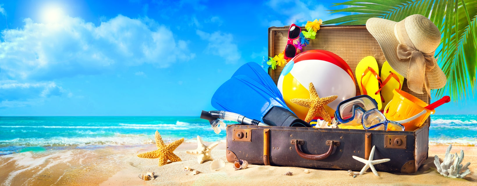 suitcase with vacation items in it