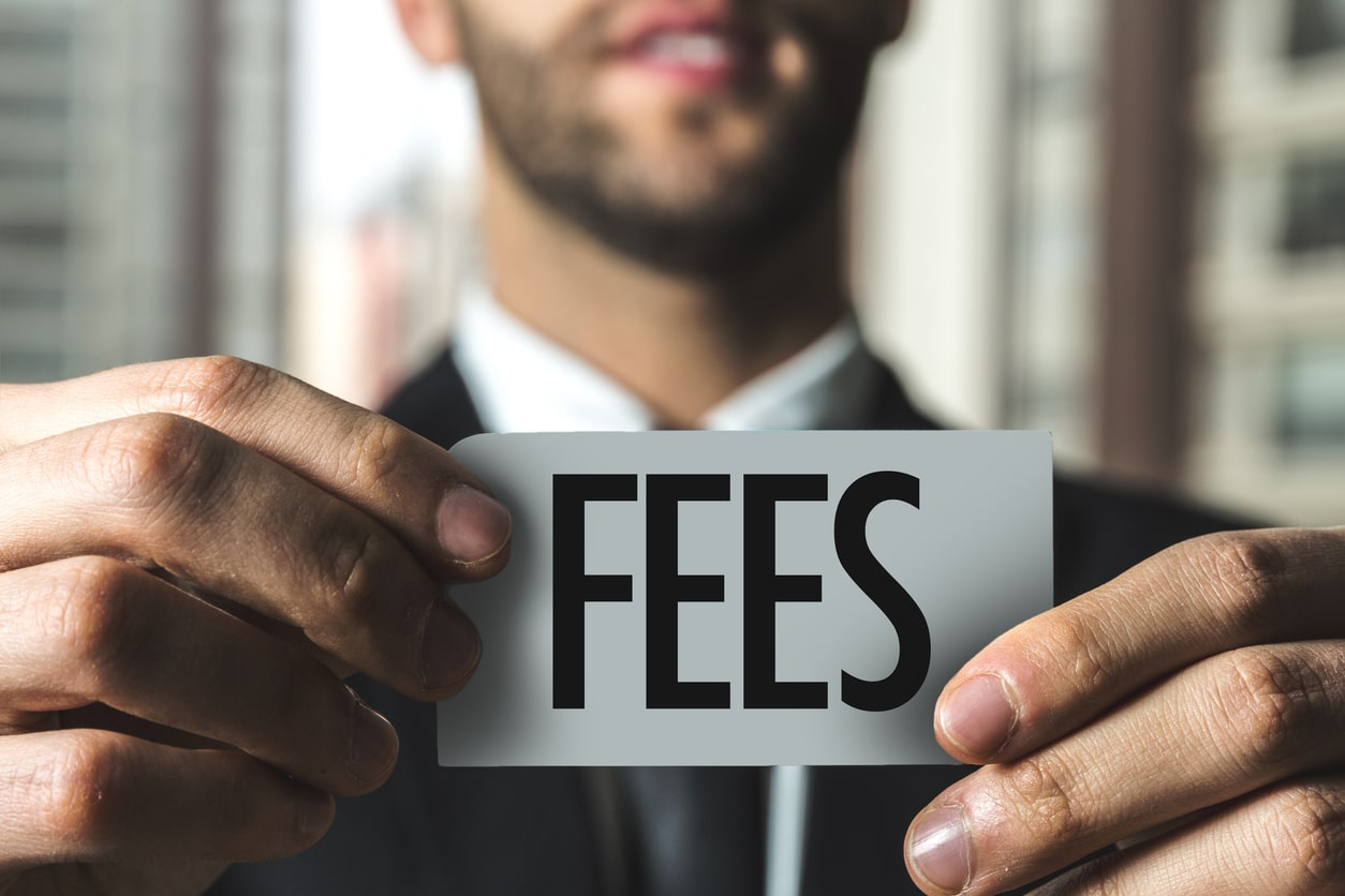 man holding fee sign