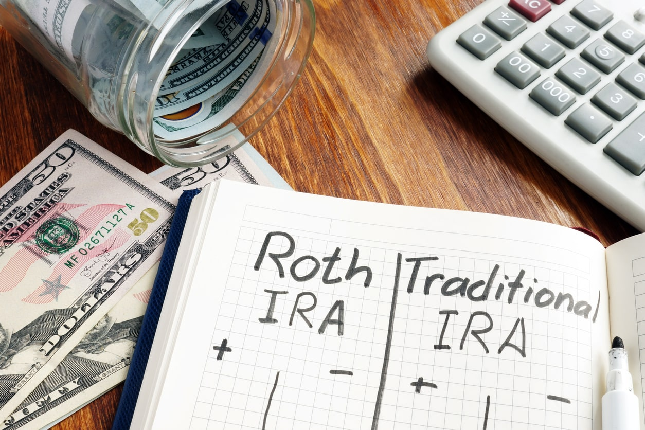 roth and traditional IRAs written on notepad